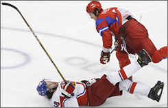 Russia's Alex Ovechkin flattens the Czech Republic's Jaromir Jagr in the third period Sunday. Seconds later, Evgeni Malkin scored his second goal of the game.