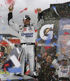Jimmie Johnson celebrates in victory circle after winning the Auto Club 500. The win was the fifth in 15 races on his home track.