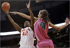 Ohio State's Jantel Lavender shoots over Michigan State's Allyssa DeHaan during the unranked Spartans' victory over the ninth-ranked Buckeyes Sunday in Columbus, Ohio.