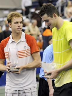 Sam Querrey, left, and John Isner chat on the court after Querrey beat Isner in the final of he Regions Morgan Keegan Championship in Memphis on Sunday. The two close friends will be part of the U.S. Davis Cup team March 5-7.