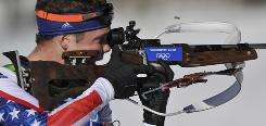 American Tim Burke shoots from the standing position on his third shoot. Burke finished 18th.