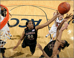 Florida State's Chasity Clayton (00) battles traffic to grab the rebound during the Seminoles' 59-58 win over Virginia.