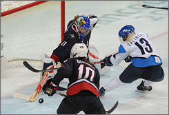 Jessie Vetter makes one of her 23 saves against Finland in the third game of the tournament.