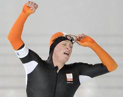 The Netherlands' Sven Kramer reacts with disbelief as he crosses the finish line during the men's 10,000 meter speed skating race Tuesday. Kramer was disqualifyed for failing to switch one lane.