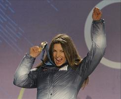 Silver medalist Julia Mancuso celebrates her medal in the super combined slalom.