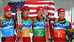 USA's nordic combined team, from left, Bill Demong, Johnny Spillane, Todd Lodwick and Brett Camerota celebrate their silver medal in the men's team nordic combined Tuesday.