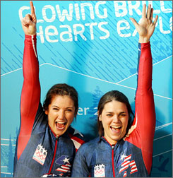 Bree Schaaf and brakeman Emily Azevedo, right, react in the finish area after their second run during the women's two-man bobsled competition Tuesday. The USA team stands tied for sixth, while Erin Pac held down second place.