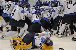 Finland's women's hockey team mob one another after picking up the country's first Olympic medal in the sport since 1998.