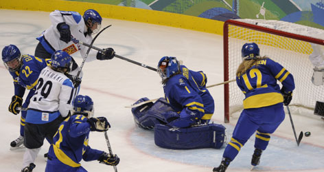 Finland's Michelle Karvinen scores past Swedish goalie Sara Grahn in the second period.