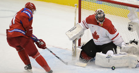 Canada goalie Roberto Luongo stones Evgeni Malkin on a late breakaway. He has gone 2-0 since replacing Martin Brodeur after Canada's preliminary-round loss to the USA.