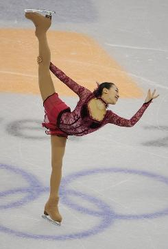 Mao Asada of Japan will have some ground to make up in Thursday night's long program in figure skating, even though she skated a strong short program on Tuesday.
