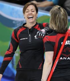 Canada's skip Cheryl Bernard, left, enjoys a laugh with teammate Cori Bartel Thursday. Bernard's Canadian team defeated Switzerland to reach the gold medal match against Sweden.