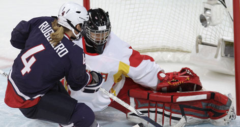 Angela Ruggiero, scoring against China earlier in the tournament, says she hopes that marching in the back of the pack at the Olympic ceremonies will help the women's hockey team finish first.