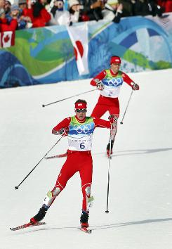 Bill Demong leads teammate Johnny Spillane to the finish line in a gold-silver finish for the USA in the nordic combined indvidual event Thursday at the Winter Olympics in Whistler.