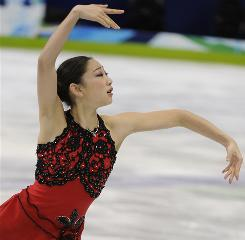 Mirai Nagasu of the USA skates in the ladies free program Thursday at the Vancouver Olympics. She now turns her attention to the World Championships next month.