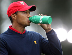 Tiger Woods drinks from a Gatorade bottle during the final round of last year's Presidents Cup in San Francisco.