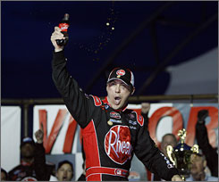 Kevin Harvick celebrates in victory lane after winning the NASCAR Nationwide race in Las Vegas.