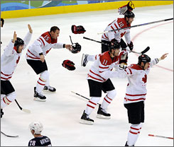 Canada players pour onto the ice following Sidney Crosby's overtime goal that gave Canada a 3-2 win and the gold medal over Team USA Sunday to close the 2010 Winter Olympics. USA earned the silver medal.