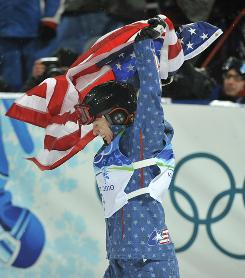Hannah Kearney celebrates after winning the gold medal in women's freestyle skiing-moguls final at Cypress Mountain on Feb. 13, the USA's first (of 37 total) medals in the Vancouver Games.
