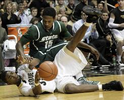 Purdue guard E'Twaun Moore, bottom, and Michigan State guard Durrell Summers battle for the ball in the first half.
