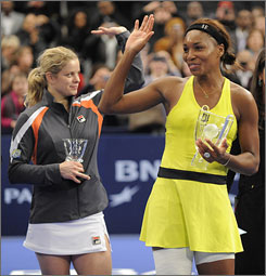 Champion Venus Williams, right, and runner-up Kim Clijsters wave to the crowd after Williams defeated Clijsters to win the Billie Jean King Cup.