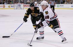 The Blackhawks' Patrick Kane, right, has had off-ice issues but has kept his focus between the boards and is the team's leading scorer.