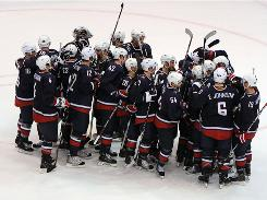 The U.S. men's hockey team celebrates after its semifinal win against Finland. The Americans' gold medal showdown with Canada drew 27.6 million viewers.