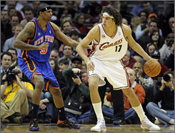 Cleveland's Anderson Varejao, right, being defended by the New York Knicks' Jonathan Bender in Monday night's game, will have to step up at center for the Cavaliers since Shaquille O'Neal is out up to eight weeks following thumb surgery.