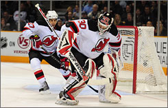 Devils goalie Martin Brodeur's struggles from the Olympics continued as he gave up three goals to the Sharks in a 2:46 span of the third period.