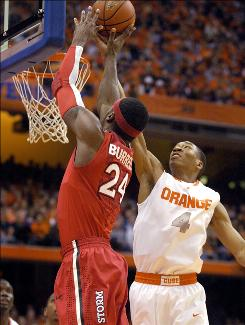 Syracuse's Wesley Johnson, right, blocks a shot by St. John's forward Justin Burrell during the first half.
