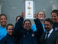 U.S. captain Shannon Boxx lifts the Algarve Cup trophy after defeating Germany 3-2 in the final.
