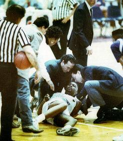 Tragic night: Officials try to help Loyola Marymount star Hank Gathers after he collapsed on the court March 4, 1990. Gathers led the nation in scoring and rebounding the season before.