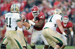 Oklahoma defensive tackle Gerald McCoy, center, is a candidate to be the first overall pick in the draft according to St. Louis Rams general manager Billy Devaney.