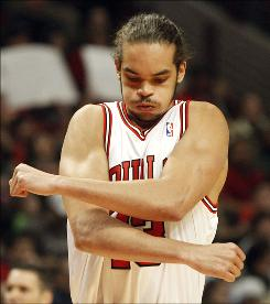 The Chicago Bulls' Joakim Noah stretches his arms as he enters the game against the Portland Trail Blazers during the first half on Feb. 26 in Chicago. Noah is averaging 10.7 points and 11.4 rebounds.