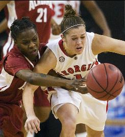 Georgia guard Ashley Houts, right, steals the ball away from Alabama guard LaToya King late in the second half.