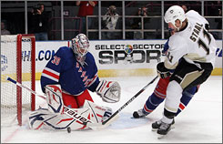The Penguins' Jordan Staal slips the puck past Rangers goalie Henrik Lundqvist in the first period.