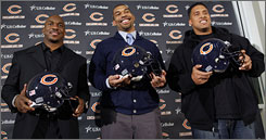 From left, Chester Taylor, Julius Peppers and Brandon Manumaleuna are introduced as Chicago Bears on Friday. Considered the crown jewel of free agency, Peppers signed a six-year deal.