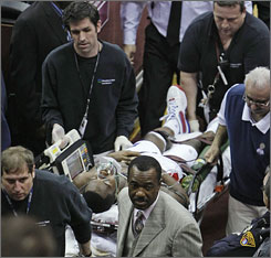 Pistons guard Rodney Stuckey is stretchered off after collapsing on the bench during the third quarter against the Cavaliers.