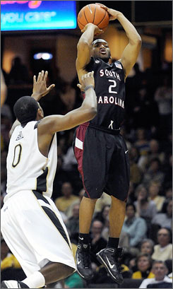 South Carolina guard Devan Downey shoots over Vanderbilt's Jermaine Beal to break a tie in the closing moments. Downey finished with 26 points.