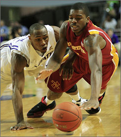 Kansas State forward Dominique Sutton, left, and Iowa State forward Marquis Gilstrap, right, dive after a loose ball during the first half of the Cyclones' 85-82 overtime win.