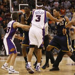 The Phoenix Suns' Jared Dudley and Steve Nash, left, hold back Indiana Pacers' Danny Granger (33) and Roy Hibbert after an altercation during the second half of their game in Phoenix. The Suns won 113-105.