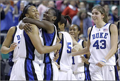 Duke seniors Joy Cheek and Bridgette Mitchell embrace as teammate Allison Vernerey (43) looks on after the Blue Devils' 70-60 win over N.C. State in the ACC tournament title game.