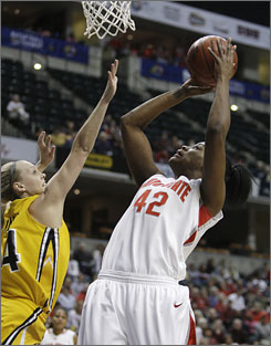 Ohio State center Jantel Lavender, right, powering up a shot against Iowa guard Jaime Printy, tallied 35 points and 10 rebounds en route to be named the Big Ten tournament's Most Outstanding Player.