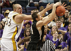 Northern Iowa's Jordan Eglseder, left, and Wichita State's Graham Hatch battle for a rebound during the Panthers' victory in the Missouri Valley Conference championship game. The win propels Northern Iowa back to the NCAA tournament.