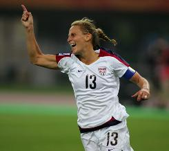 Kristine Lilly of the United States reacts after scoring against England at the 2007 World Cup in Tianjin, China.