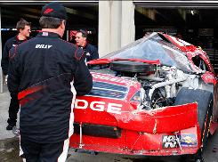 Brad Keselowski's Dodge, wrecked after a bump by Carl Edwards' Ford on Sunday, sits in the garage.