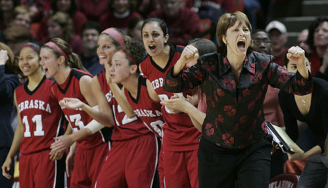 Coach Connie Yori, right, and her players savor the last moments of a Feb. 24 win that clinched the Big 12 regular-season title for Nebraska.