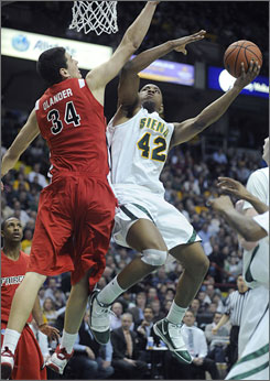 Siena's Alex Franklin goes up for a shot against Fairfield's Ryan Olander during the Saints' 72-65 overtime win over Fairfield in the MAAC title game.