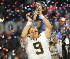 Drew Brees displays the Super Bowl trophy after leading the Saints to their upset of the Colts.