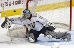 Predators goalie Dan Ellis blocks a shot in the second period Tuesday night in Atlanta. The Predators jumped to an early 2-0 lead in the first period, while the Thrashers only managed one goal in the second.